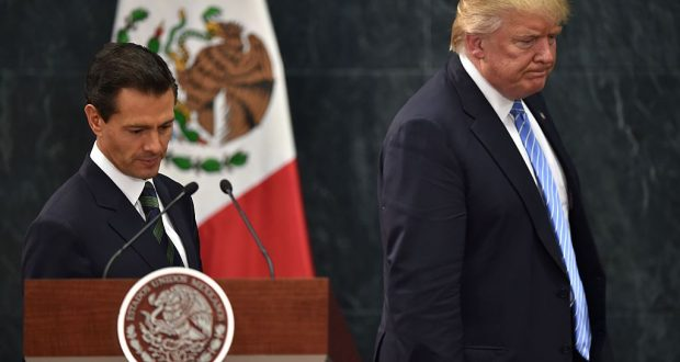 US presidential candidate Donald Trump (R) and Mexican President Enrique Pena Nieto        (Photo credit should read YURI CORTEZ/AFP/Getty Images)