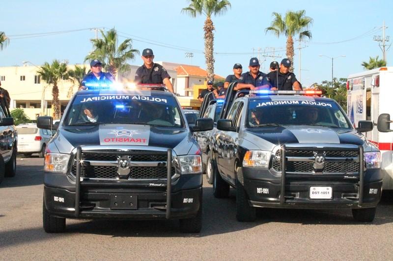 camionetas y policías