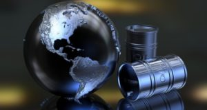 barriles de petróleo junto a un globo terráqueo con el continente americano