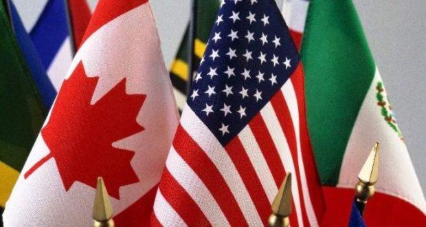 Las banderas de México, Canadá y Estados Unidos seguirán conformando el nuevo TLCAN