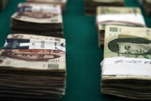 Burócratas mexicanos ganan más que funcionarios de Suiza: OCDE
