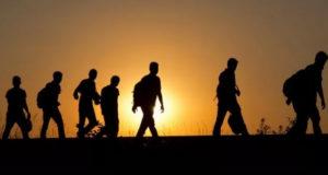 inmigrantes en el muro de Estados Unidos