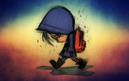 Niño en la lluvia.